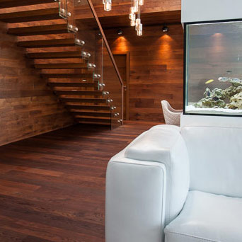 Custom, handmade wood flooring, staircase and walls
