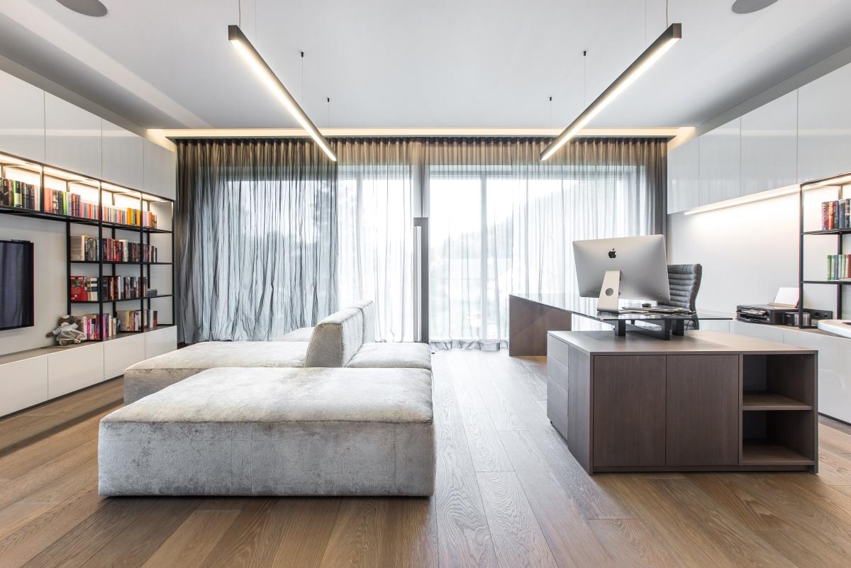 Custom hardwood flooring in luxurious house boardering pine forest